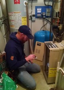 Owner Jeremy Salzbrun, seen here, or any of his highly skilled team can come out to perform furnace maintenance before winter comes!
