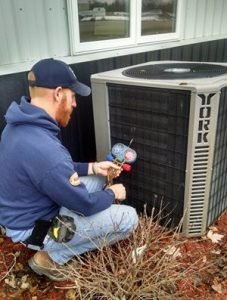 Jeremy Salzbrun testing an air conditioner.
