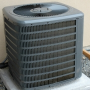 Outdoor air conditioner unit with air filter needing replacement.