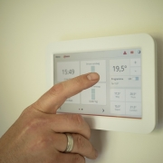 A touch-screen thermostat.