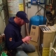 H&S Heating and Air Conditioning owner Jeremy Salzbrun troubleshooting an HVAC unit at a home.