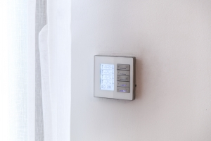 Programmable thermostat on home wall