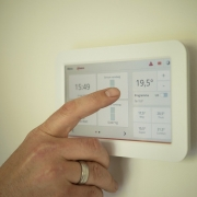 HVAC system control panel on wall.